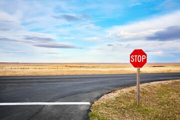 Photo sur Plexiglas Amérique du Sud Stop road sign at an intersection in Badlands National Park, South Dakota, USA.