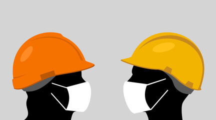 People with hardhats and face masks
