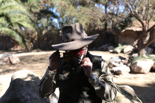 A zoo worker adjusts his face mask amid the outbreak of the coronavirus disease (COVID-19), at the Buin Zoo in Santiago