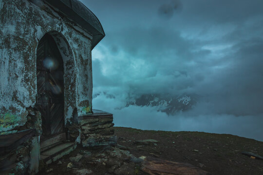 ruins of the mausoleum on the top of the mountain alps Austria just before heavy reain
