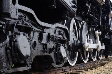 Up close details of the drive wheels of a steam locomotive