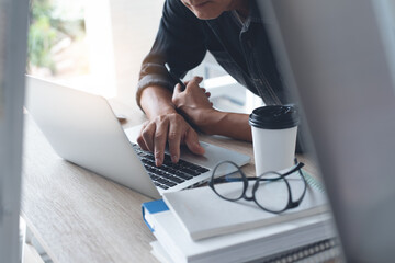Casual business man or freelancer working on laptop computer from home office
