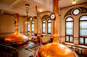 AMSTERDAM, NETHERLANDS - JUN 3, 2015: Interior of the Heineken Experience center, a historic brewery for Heineken beer. Gerard Adriaan Heineken was a founder of the Heineken beer