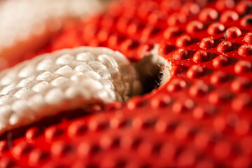 Extreme macro photo of an AFL football. Sports background.