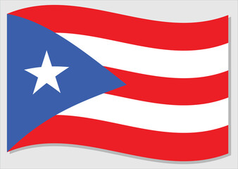 Waving flag of Puerto Rico vector graphic. Waving Puerto Rican flag illustration. Puerto Rico country flag wavin in the wind is a symbol of freedom and independence.
