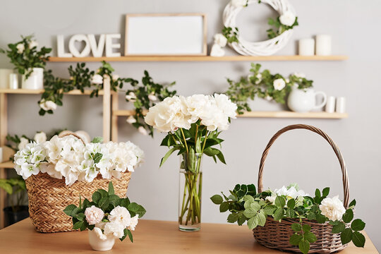Floral background. Flower shop interior. Floral design studio, making decorations and arrangements. Flowers delivery service and sale of home plant, creating order. Peonies and roses.