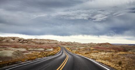 Photo sur Plexiglas Amérique du Sud Stormy clouds over road in Badlands National Park, travel concept, South Dakota, USA.