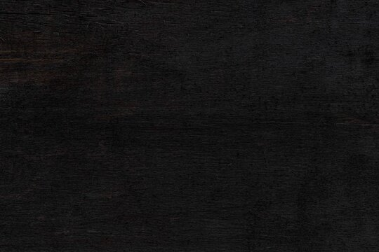 Black wood texture background. Abstract dark wood texture on black wall. Aged wood plank texture pattern in dark tone