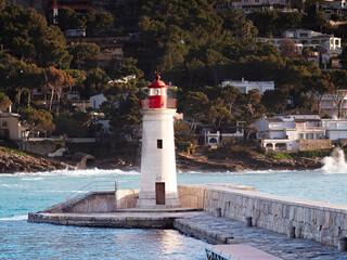 Lighthouse on mole. Port d'Andratx harbor
