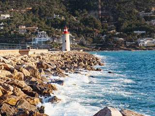 Lighthouse at harbor entrance. Mallorca port