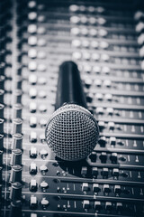 dynamic microphone on audio mixing board