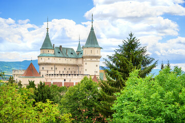 View of neogothic Bojnice castle over treetops of Castle park (Bojnice, Slovakia)
