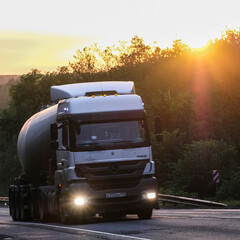 Moscow region, Russia - June, 11, 2020: image of a country highway at sunset