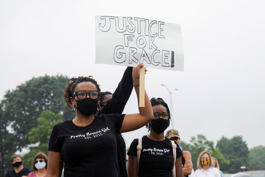 Students protest outside Groves High School in support of a fellow student who was jailed in a Detroit suburb
