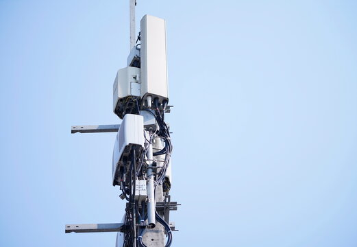 Telecommunication tower of 4G and 5G cellular. Macro Base Station. Wireless Communication Antenna Transmitter. Telecommunication tower with antennas against blue sky background.
