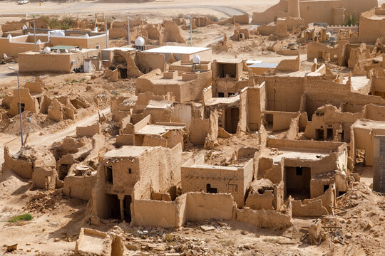 View of the small village Raghba with the abandoned mud houses in the middle of the desert in Saudi Arabia