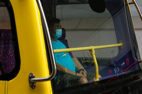 A man wears a surgical mask on a bus, following the coronavirus disease (COVID-19) outbreak, in Hong Kong