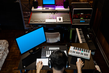 back of asian producer, sound engineer working in recording, broadcasting studio