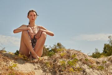 slim woman sunbathes