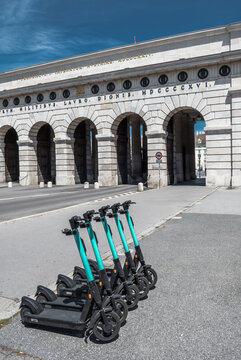 Rental Electric Scooters, e-scooter, Parked In Group In Front Of Historic Building In Vienna Austria