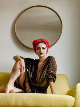 portrait of a young woman with a red turban, design mood