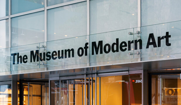 Main entrance with glass doors of the MoMA (Museum of Modern art) In Manhattan, New York