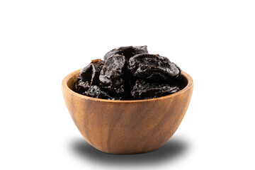 Fototapete - Dried pitted prunes in wooden bowl on white background.
