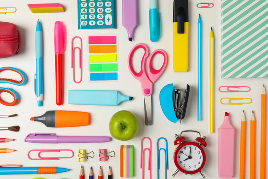 Flat lay with different school supplies on white background