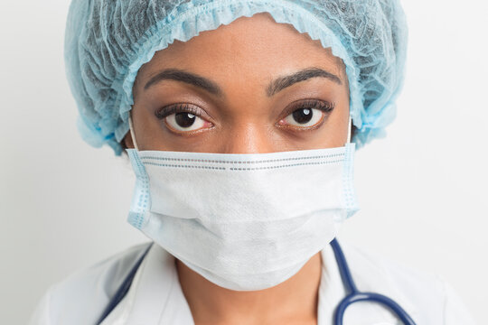 Portrait of an African American female doctor in a medical protective mask. The face of a black nurse. Close-up