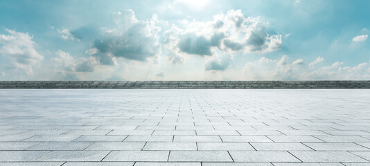Empty square floor and blue sky with white clouds scene.
