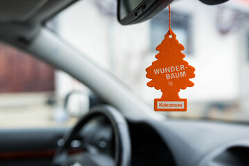 Miercurea Ciuc, Romania- 30 December 2018: Hanging Coconut Wunder Baum air freshener on car interior, shallow depth of field.