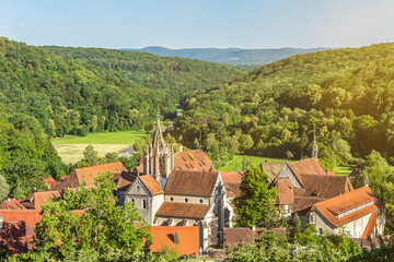 Scenic ancient monastery of Bebenhausen surrounded by forest in Southern Germany on a sunny evening