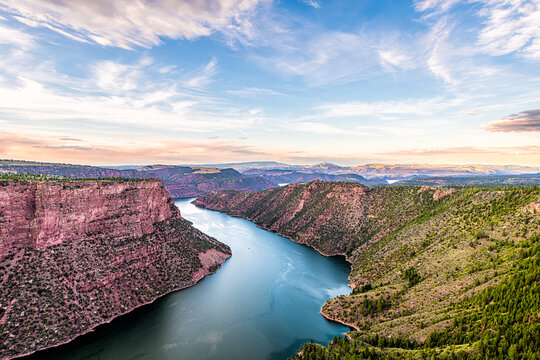 Aerial above view from Canyon Rim trail overlook near campground in Flaming Gorge Utah National Park with Green River at sunset