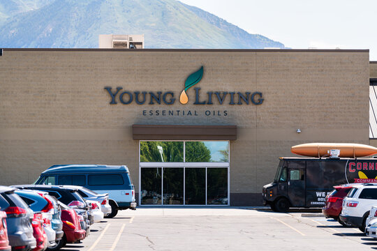 American Fork, USA - July 29, 2019: Young Living Essential Oils Member Services headquarters company warehouse in Utah with parking lot cars by sign entrance