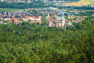 Aerial view of Bojnice castle surrounded by castle park and town of Bojnice (Slovakia)