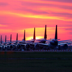 airplanes at airport apron with beautiful sky background