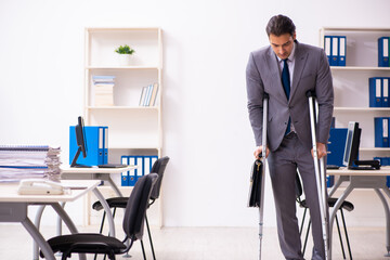 Fototapeta Leg injured employee in the office