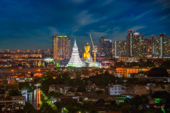 The Big Buddha statue, approximately 69 meters in height of Pak Nam Temple that is located in the center of Bangkok in Thailand. Taken picture at night.