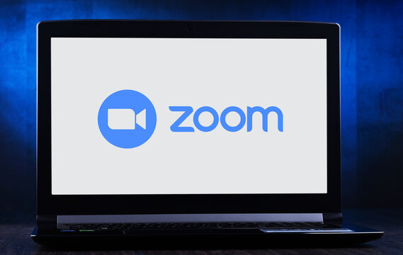 Laptop computer displaying logo of Zoom