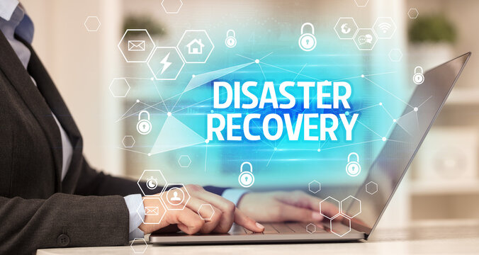 DISASTER RECOVERY inscription on laptop, internet security and data protection concept, blockchain and cybersecurity