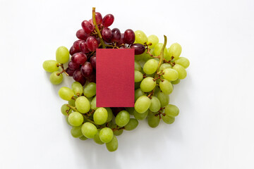 red business card on a bed of grapes