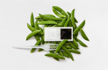 salt and pepper take away bags with beans and a fork
