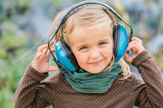 Happy girl wearing earmuffs