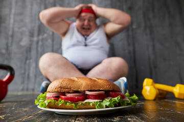 fat caucasian man cannot control himself, hungry man has a mad desire to eat sandwich. male in...