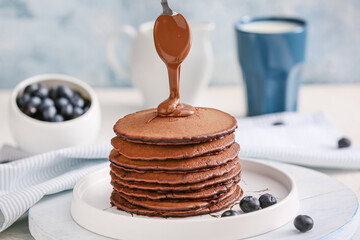 Decorating of delicious chocolate pancakes
