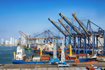 January 27, 2019, Cartagena, Columbia. Port with cargo ships, cranes and containers at the pier of the Port of Cartagena, Colombia