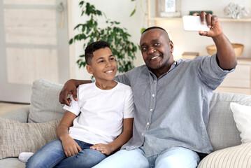 Bonding With Grandchildren. Happy Black Grandpa Taking Selfie On Smartphone With Grandson