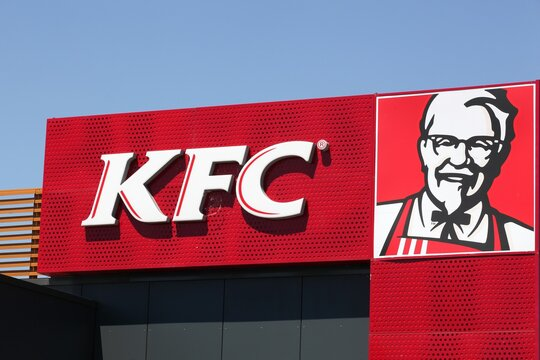Mably, France - May 31, 2020: KFC logo on a facade. KFC is a fast food restaurant chain that specializes in fried chicken and is headquartered in Louisville, Kentucky, in the United States