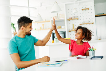 homework teaching girl high five education father children daughter familiy childhood success child