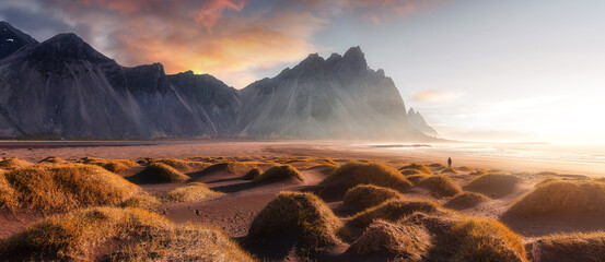 Vestrahorn mountaine on Stokksnes cape in Iceland during sunset. Amazing Iceland nature seascape. popular tourist attraction. Best famouse travel locations. Scenic Image of Iceland